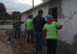 FPL Volunteers paint Veterans Habitat home